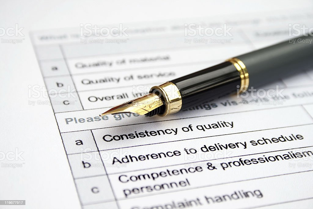 A survey form with a fountain pen royalty-free stock photo