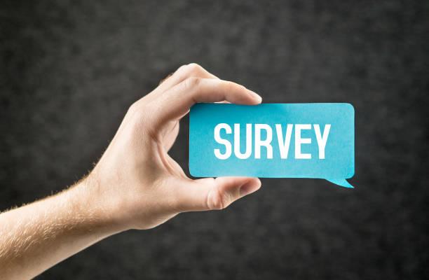 survey. giving feedback, market research, questionnaire, user experience and review concept. hand holding cardboard paper speech bubble. - feedback comunicação imagens e fotografias de stock