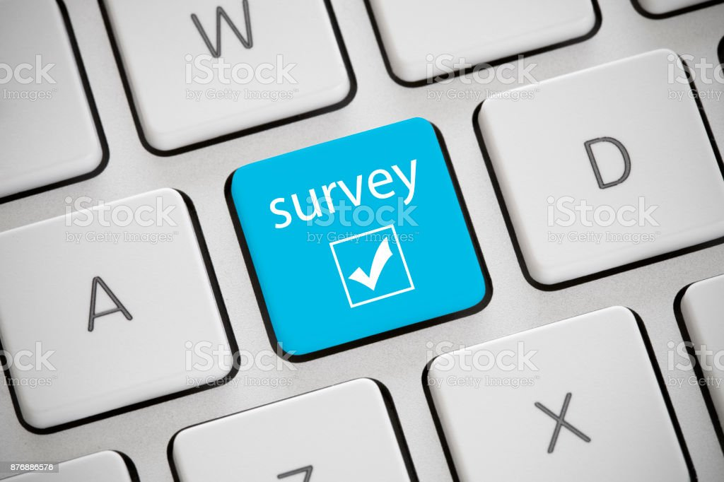 Survey Blue colored 'survey' button on a keyboard. Blue Stock Photo