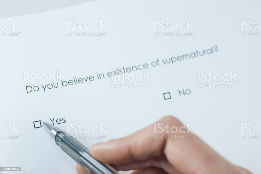 Survey question: Do you believe in existence of supernatural? stock photo