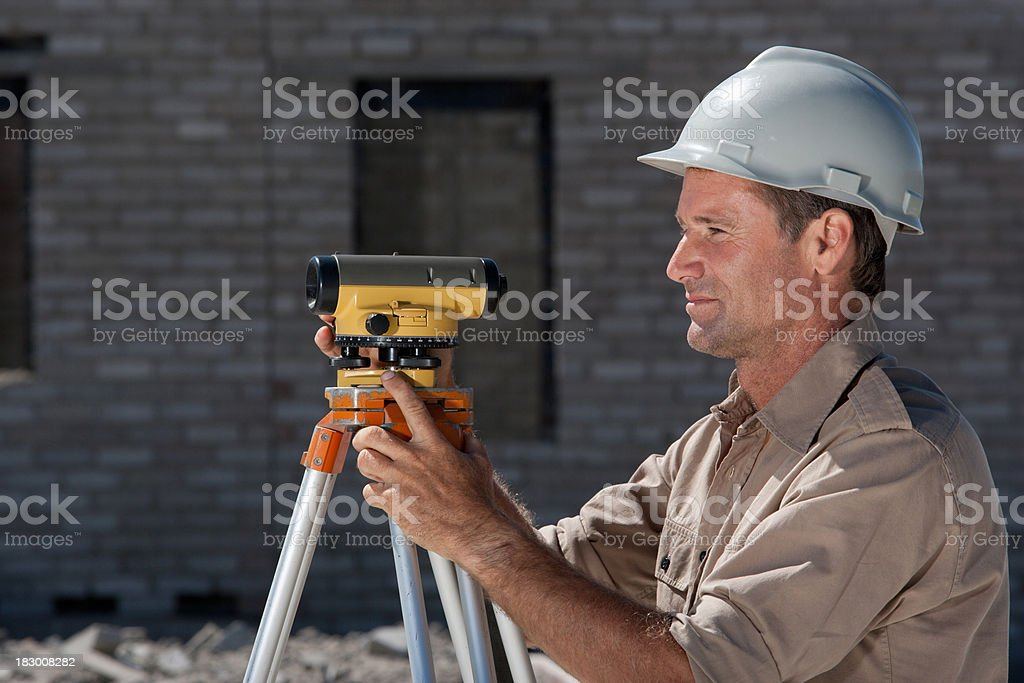 Surveyor at construction site stock photo