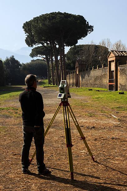 Surveyor at Pompeii ruins in Italy stock photo