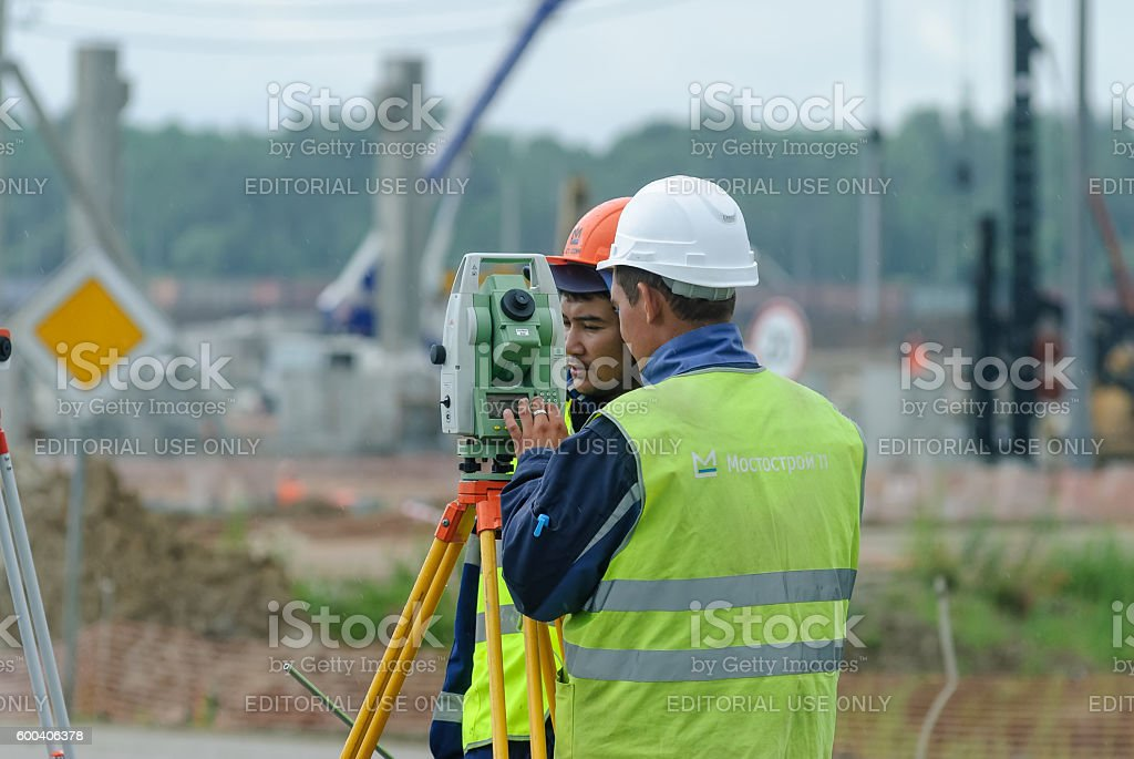 Surveyor builder worker with theodolite stock photo