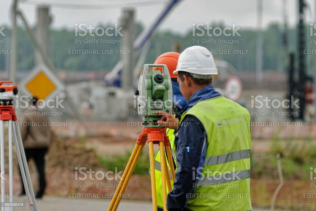 Surveyor builder worker with theodolite stock photo