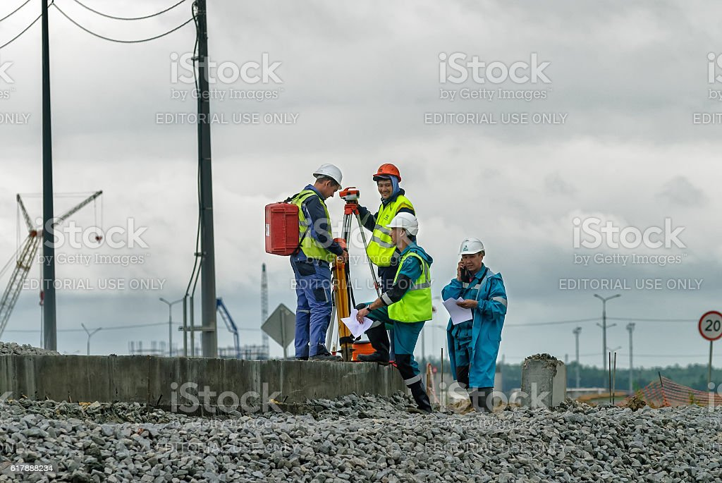 Surveyor builders worker with theodolite stock photo