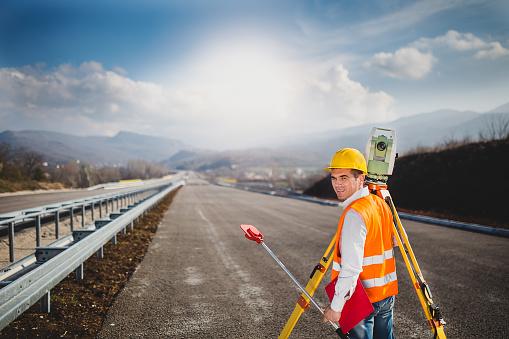Surveyor changing the digital level position