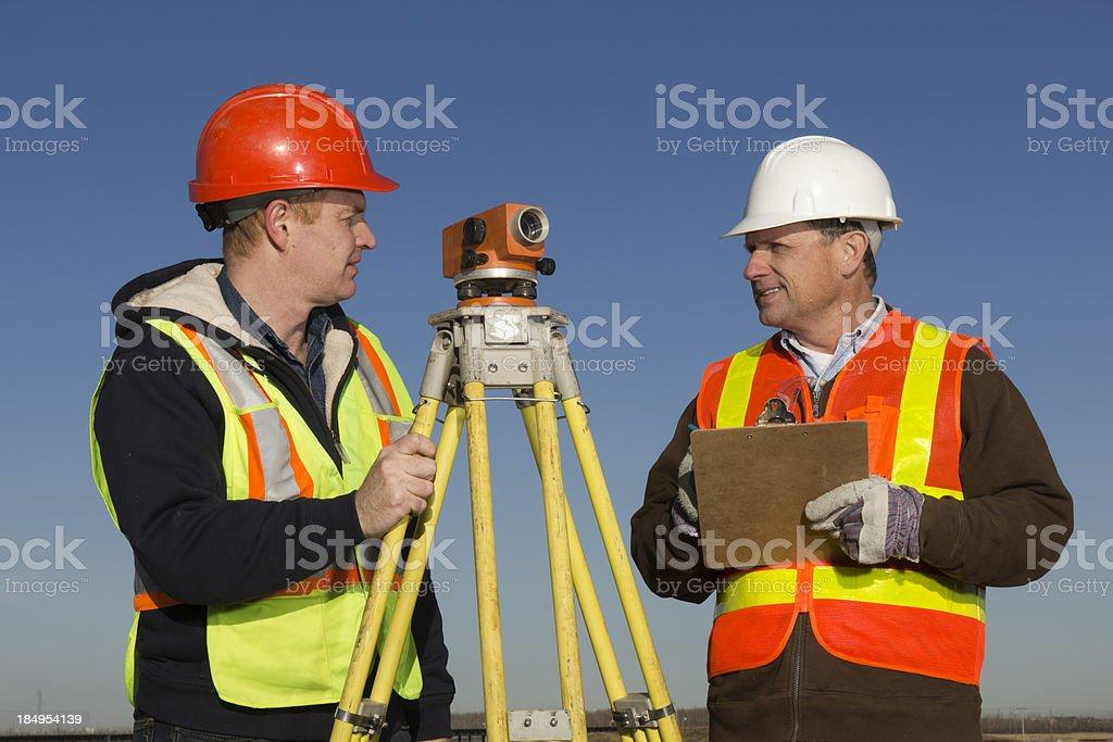 Surveyor Conversation royalty-free stock photo