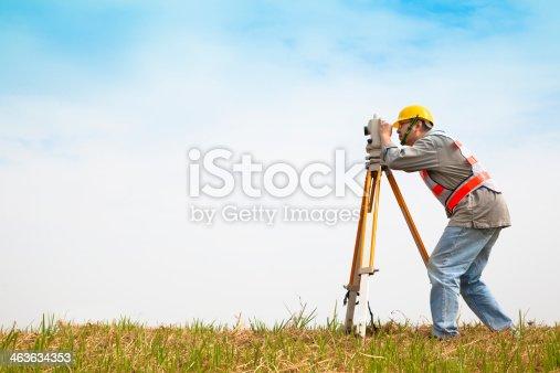 istock Surveyor engineer making measure on the field 463634353