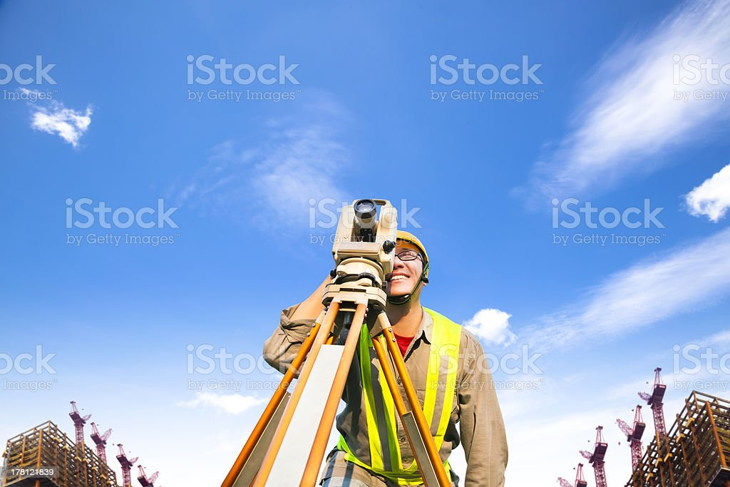 Surveyor engineer making measure stock photo