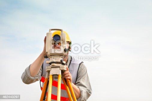 istock Surveyor engineer making measure with cloud background 462443297