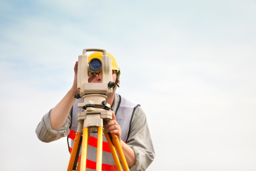 istock Surveyor engineer making measure with cloud background 462443297