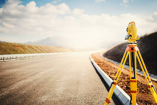 surveyor equipment at construction site - land stock photos and pictures