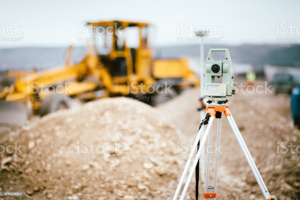 Surveyor equipment GPS system or theodolite outdoors at highway construction site. Surveyor engineering with total station stock photo
