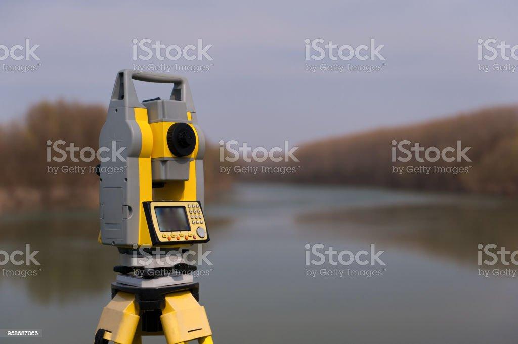 Surveyor equipment on a tripod stock photo