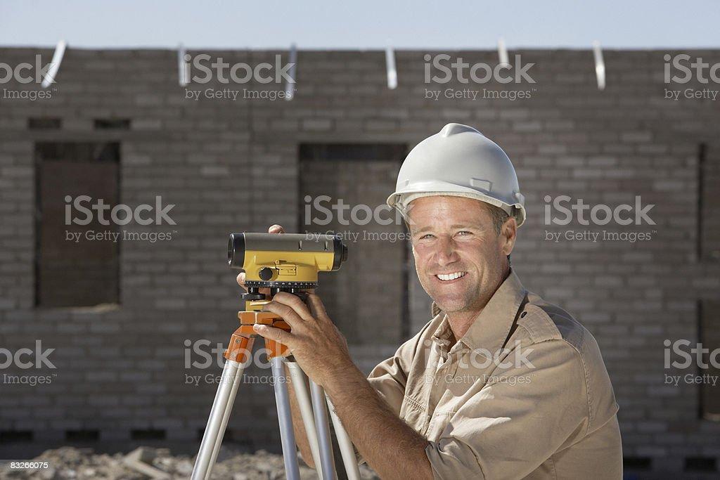 Surveyor on new construction site royaltyfri bildbanksbilder
