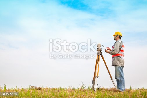 istock A surveyor taking measurements outdoors 463758761