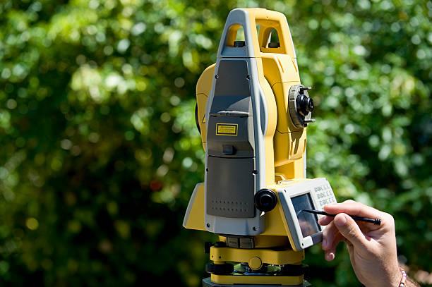 surveyor with theodolite stock photo