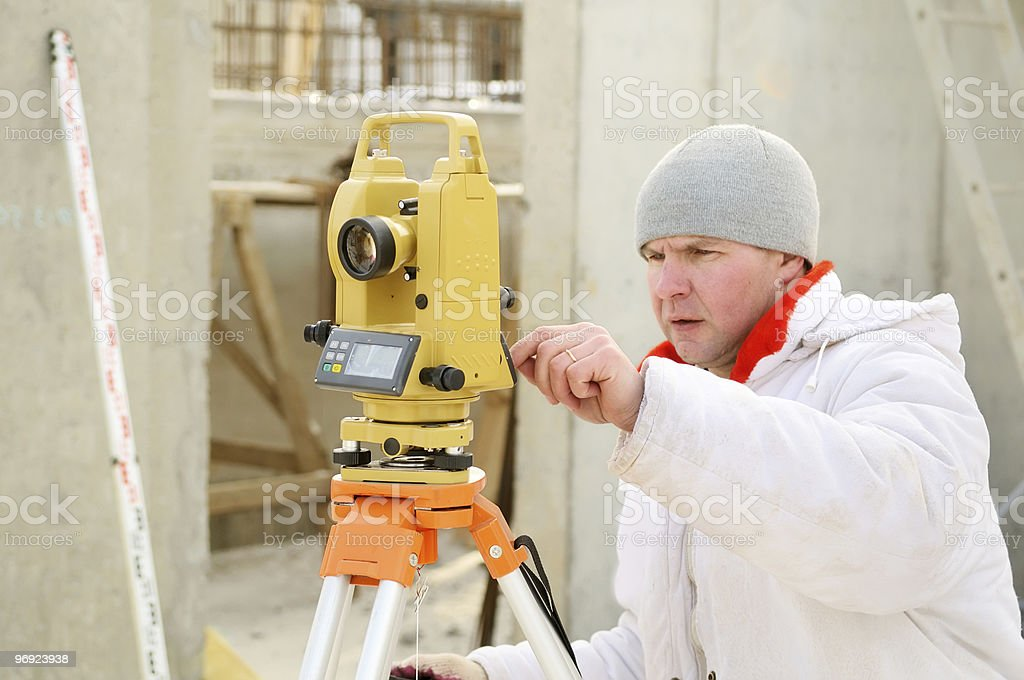 surveyor worker at construction site royalty-free stock photo