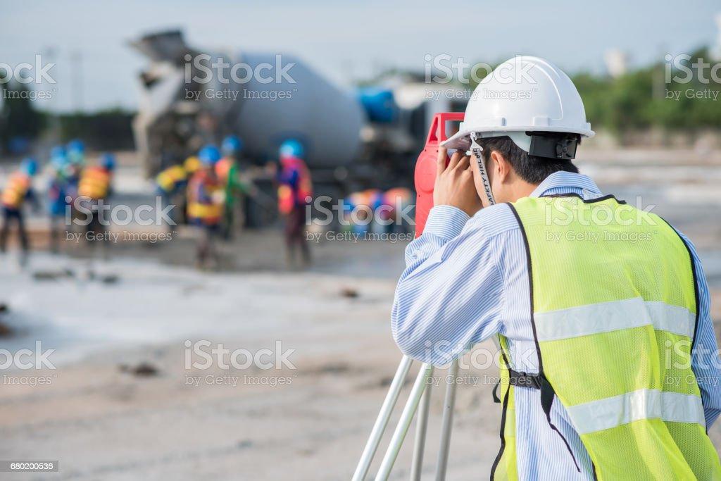 Surveyor worker using theodolite stock photo