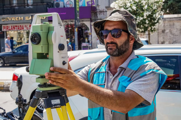 Surveyor worker with theodolite in Istanbul stock photo