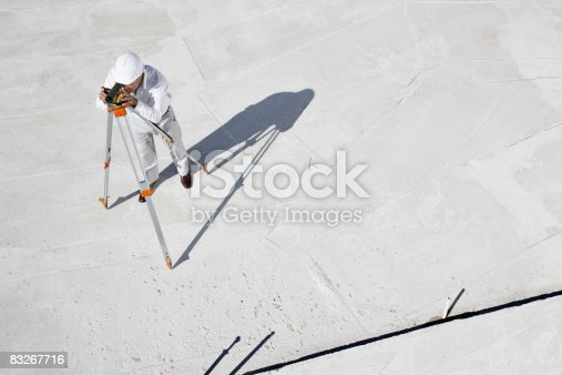 istock Surveyor working at new construction site 83267716
