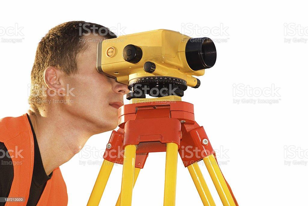 Surveyor working with digital level royalty-free stock photo