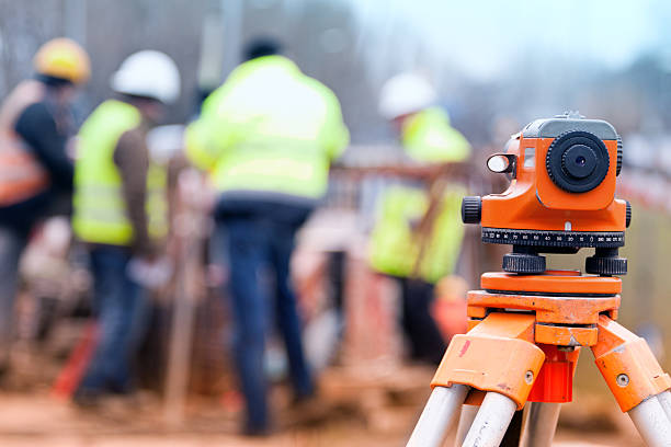 Surveyors and construction site stock photo