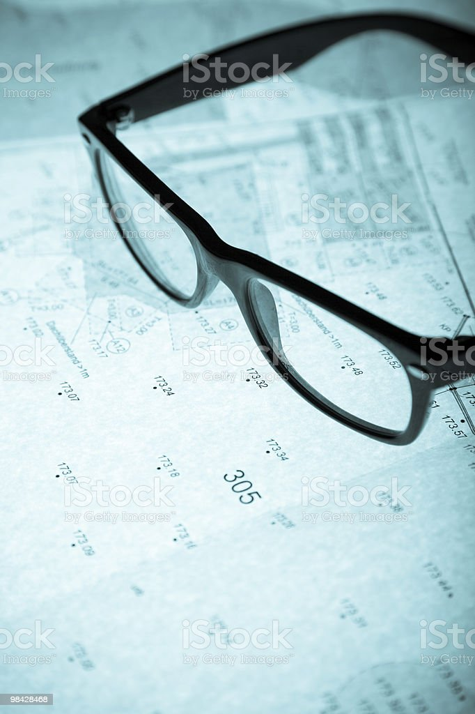 surveyor's plan and retro glasses with backlight royalty-free stock photo