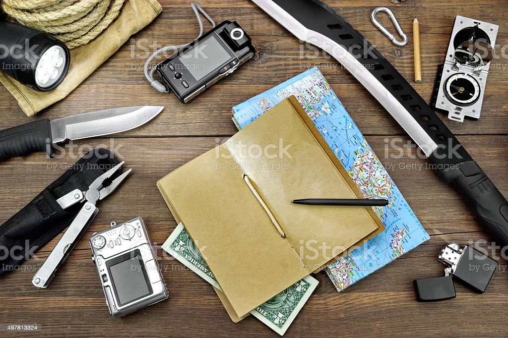 Survival Kit Laid Out On The Wood Floor stock photo