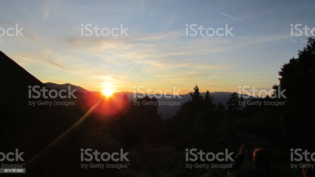 suset Behind the mountains stock photo