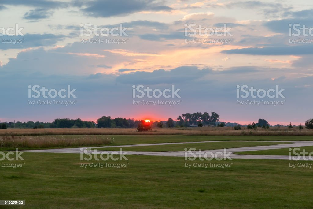 Suset over the airfield stock photo