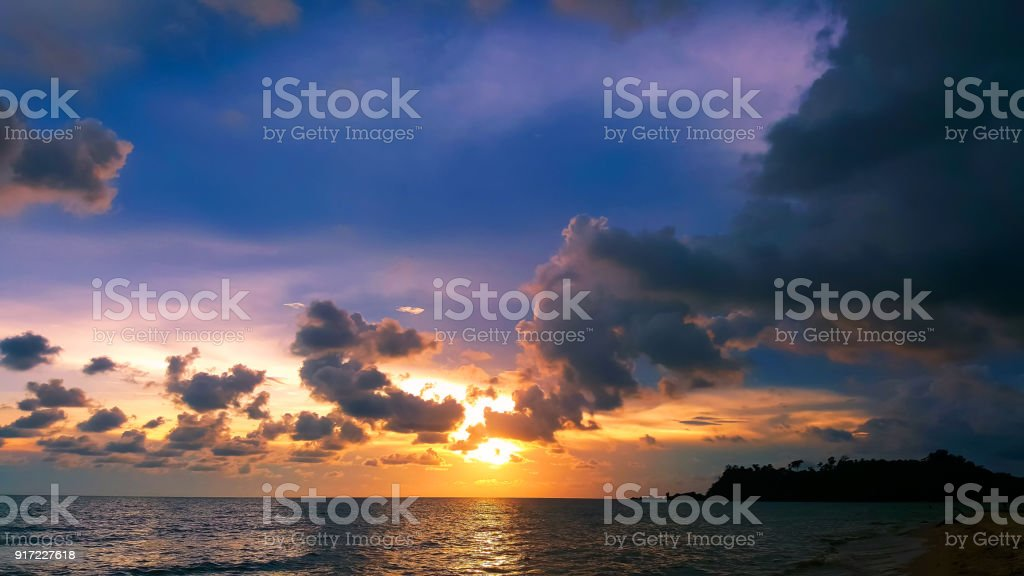 Suset sky with cloud  at beatiful beach stock photo