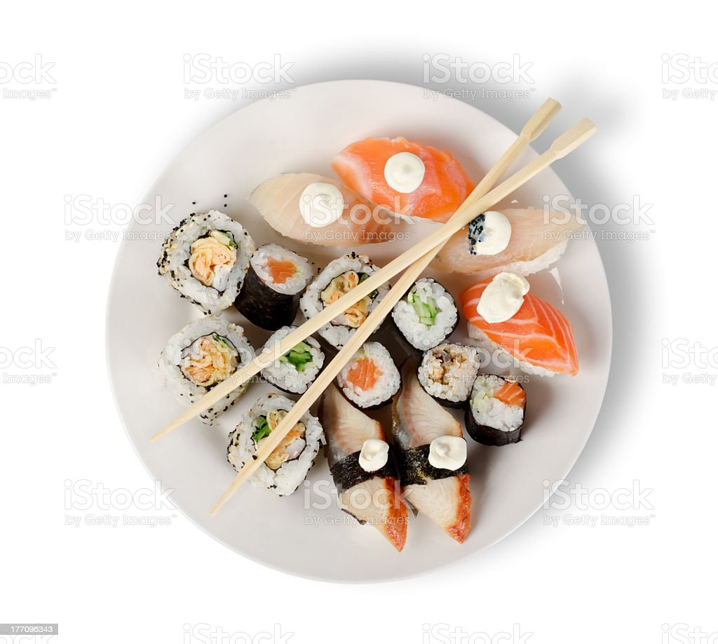 Sushi and chopsticks on a white plate royalty-free stock photo
