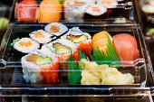 Sushi and maki food in asian fast food restaurant