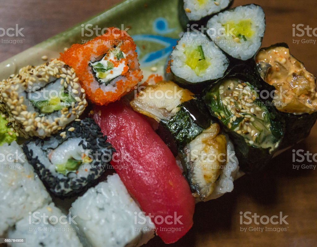 Sushi and rolls on a rectangular plate royalty-free stock photo