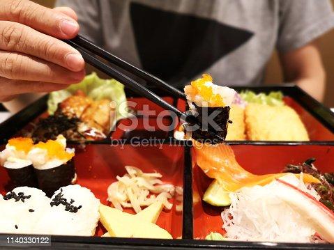 istock sushi and sashimi with japanese bento 1140330122