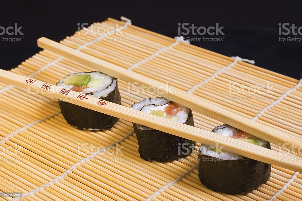 Sushi and wooden chopsticks royalty-free stock photo