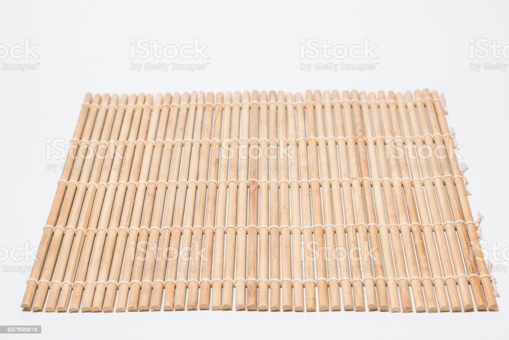 sushi bamboo mat on white background stock photo