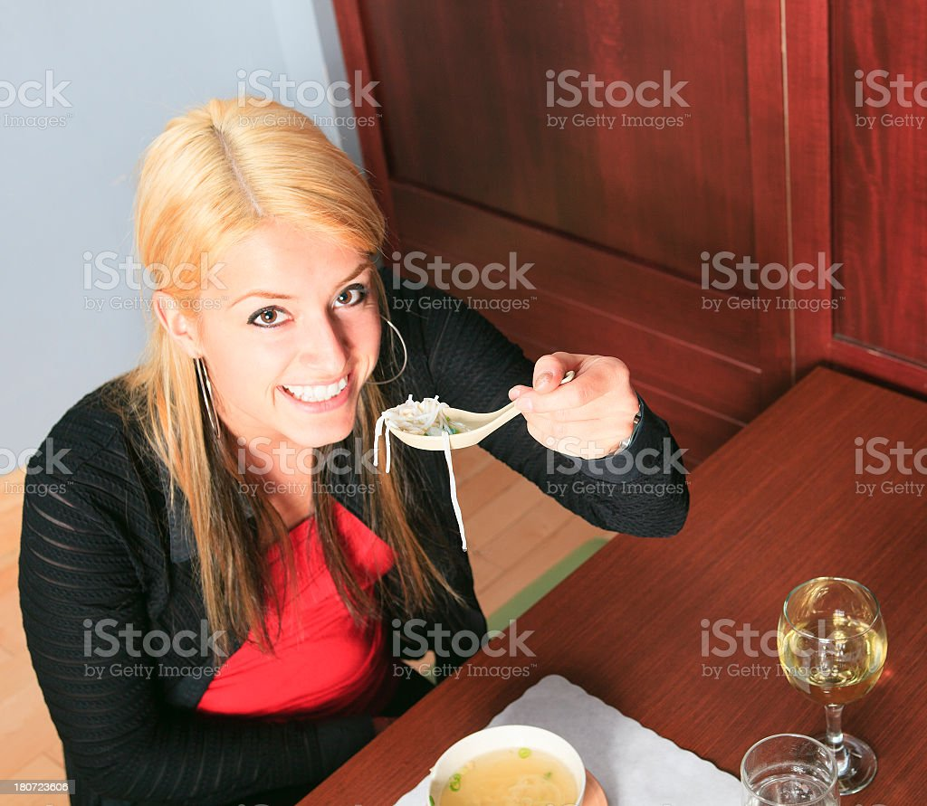 Sushi Bar - Happy Woman Soup royalty-free stock photo