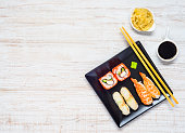 Sushi Black Plate with Soy Sauce and Ginger Copy Space