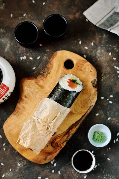 Sushi Burrito with salmon, cucumber, sweet pepper and cream cheese stock photo