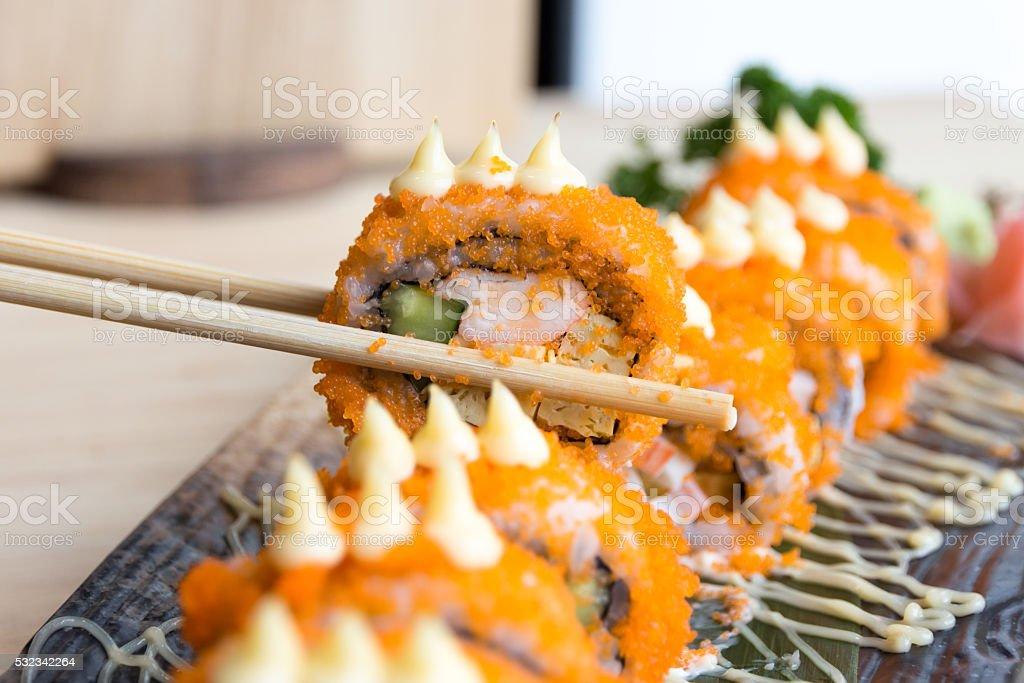 Sushi California rolls with chopsticks - Japanese food royalty-free stock photo