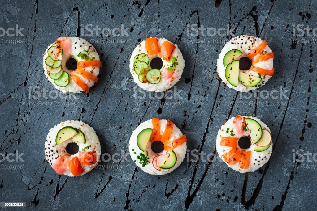 Sushi donuts set on black background. Flat lay, top view stock photo