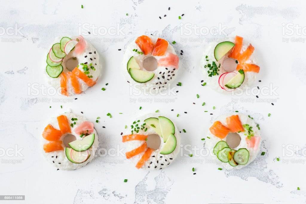 Sushi donuts set on white background. Flat lay, top view stock photo