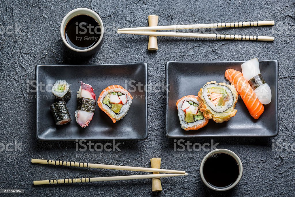 Sushi for two served on black stone stock photo