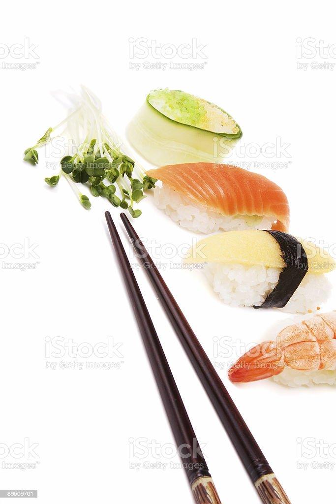 Sushi, green and chopsticks royalty-free stock photo