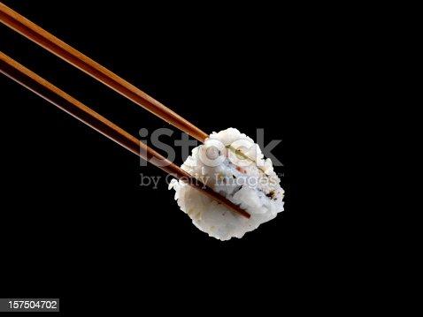 istock Sushi in Chopsticks 157504702
