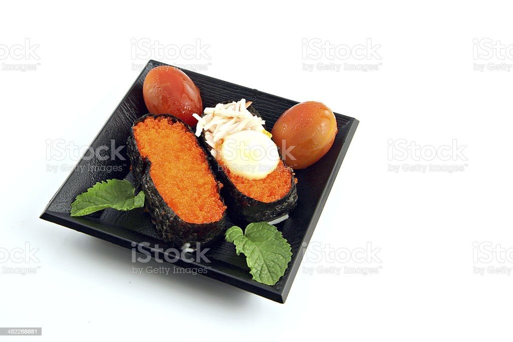 Sushi in dish and the tomatoes on side. royalty-free stock photo
