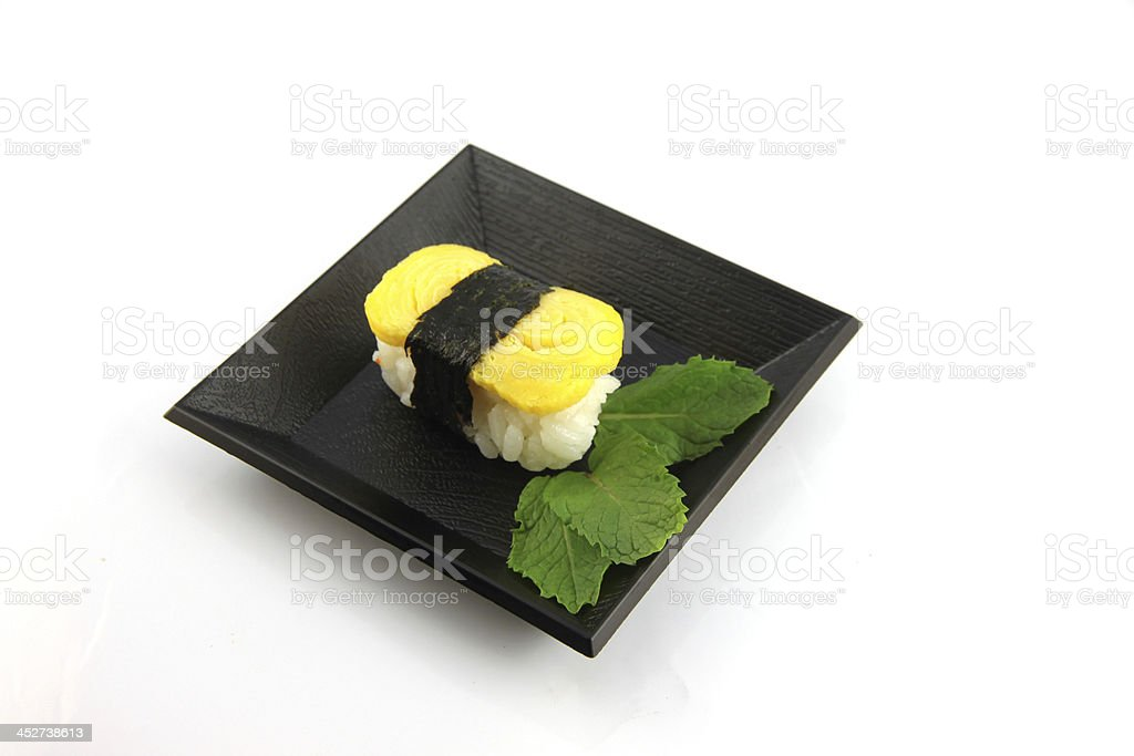 Sushi made from egg on dish. royalty-free stock photo