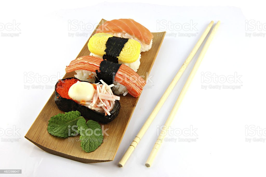 Sushi made from seafood and Chopsticks placed on the side. royalty-free stock photo